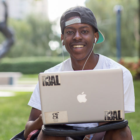 Male Student with Laptop